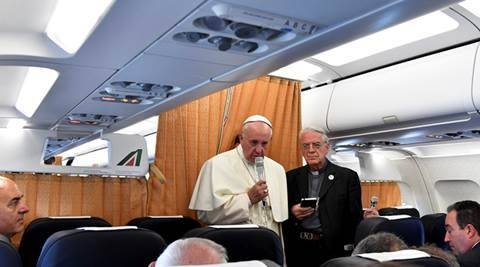 Pope Francis speaks to journalists on his flight back to Rome following a visit at Armenia on June 26, 2016. REUTERS/Tiziana Fabi/Pool