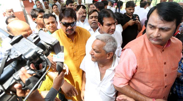 Samajwadi Party MLA Guddu Pandit(in Yellow Dress)along with Bhartiya janta Party MLA Sangeet Som(In Brick Colour Dress)and some other MLAs Blaming on Samajwadi Party Senior Leader Shivpal Singh Yadav,Yadav Trying to stop them to cast their vote for rajya Sabha election at state assembly in Lucknow on saturday.Express photo by Vishal Srivastav 11.06.2016