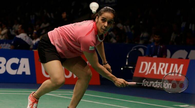 India's Saina Nehwal returns a shot to Spain's Carolina Marin during their quaterfinal women's single match at the Indonesia Open badminton tournament at Istora Stadium in Jakarta, Indonesia, Friday, June 3, 2016. (AP Photo/Achmad Ibrahim)