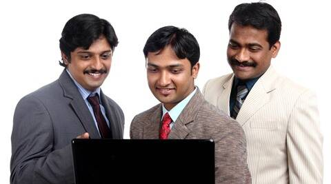 Happy Indian business people working in laptop