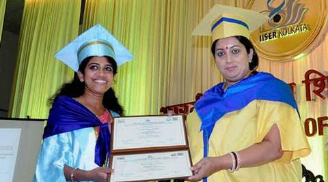 Nadia: Union HRD Minister Smriti Irani presenting certificate to a student during 4th Convocation of the Indian Institute of Science Education & Research in Nadia district of West Bengal on Tuesday. PTI Photo   (PTI6_28_2016_000179A) *** Local Caption ***