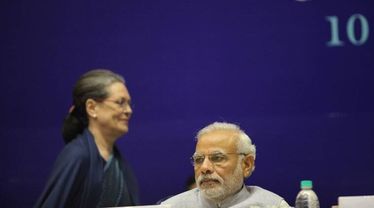 Congress President Sonia Gandhi passes by PM Modi during a felicitation programme for Sharad Pawar on his 75th bday in New Delhi on thursday. Express Photo by Tashi Tobgyal New Delhi 101215