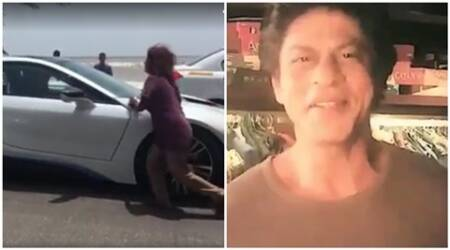 Watch: Shah Rukh Khan's new BMW i8 stopped by a homeless woman in Mumbai