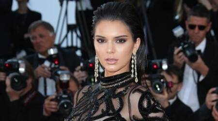 Model Kendall Jenner poses for photographers upon arrival at the screening of the film Mal De Pierres at the 69th international film festival, Cannes, southern France, Sunday, May 15, 2016. (AP Photo/Joel Ryan)