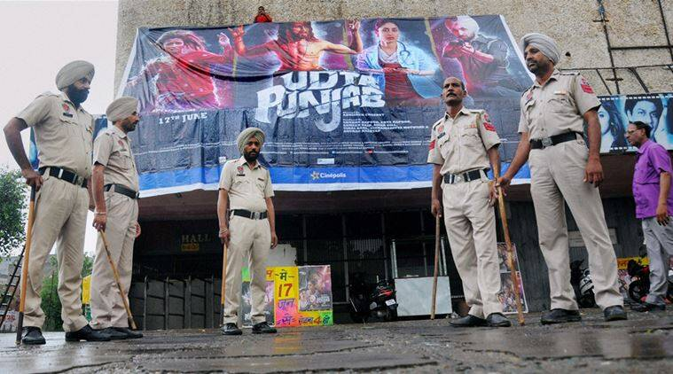Amritsar: Policemen guarding a local cinema hall on the release of movie Udta Punjab in Amritsar on Friday.PTI Photo(PTI6_17_2016_000046B)