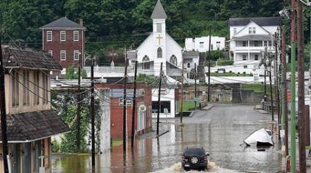 West Virginia floods: At least 23 dead as crews rescue the stranded