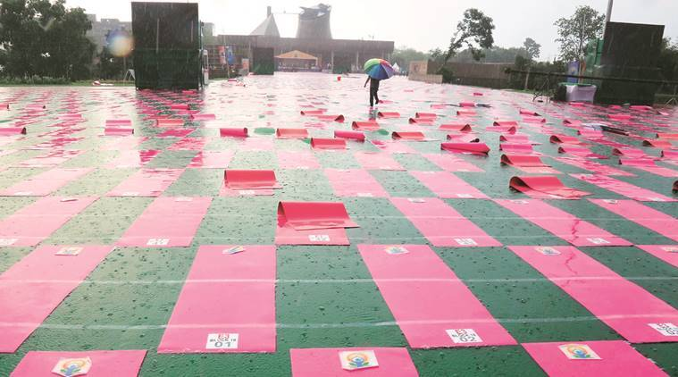 International yoga day, yoga day, cahndigarh yoga day, yoga day rain, yoga venue waterlogged, chandigarh administration, narendra modi, capitol complex, chandigarh rain, indian express news, indian express yoga day, yoga day updates, india news