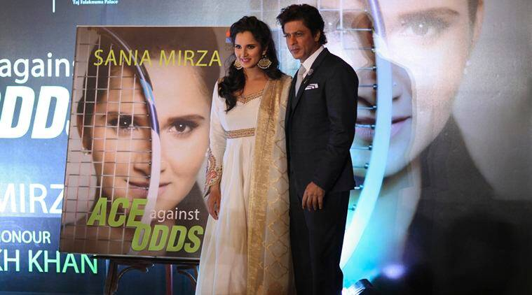 Indian tennis player Sania Mirza, left and Bollywood superstar Shahrukh Khan pose during the release of Sania's autobiography 'Ace Against Odds' in Hyderabad, India, Wednesday, July 13, 2016. The book is co authored by Sania's father Imran Mirza and Journalist Shivani Gupta.(AP Photo/Mahesh Kumar A.)