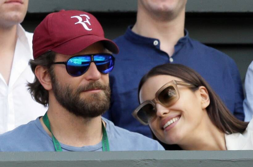 Actor Bradley Cooper and model Irina Shayk watch the action on centre court during day ten of the Wimbledon Tennis Championships in London, Wednesday, July 6, 2016. (AP Photo/Tim Ireland)