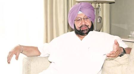 Parkash Singh Badal, Amrinder Singh, Badal spreading misinformation, Congress, SAD, Punjab, Chandigarh, Indian Express