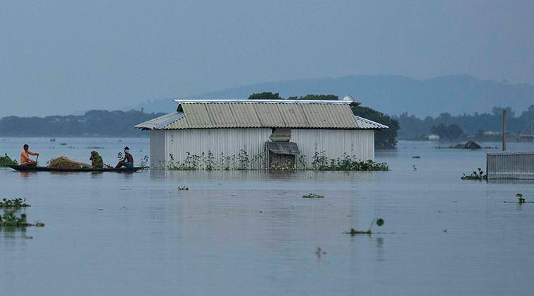 Flood affected people travel on a boat at Sildubi village, in the northeastern Indian state of Assam, Friday, July 29, 2016. Torrential monsoon rains have caused widespread flooding in Assam state and forced around 1.2 million people to leave their water-logged homes. (AP Photo/Anupam Nath)