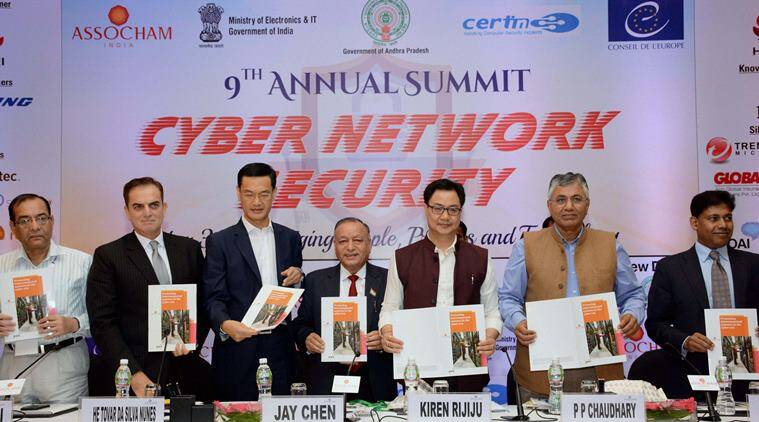 New Delhi: Kiren Rijiju, Minister of State for Home Affairs and P.P. Chaudhary, Minister of State for Electronics and IT releasing the ASSOCHAM-PwC Study Paper titled 'Protecting interconnected systems in the cyber era' at ASSOCHAM's 9th Annual Summit on Cyber & Network Security in New Delhi Friday. PTI Photo (PTI7_29_2016_000139A)