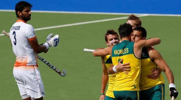 Australia's Chris Ciriello (R) celebrates his goal with teammates Mark Knowles (2nd R) and Jacob Whetton (2nd L) as India's Rupinder Singh looks on in the men's gold medal field hockey match at the 2014 Commonwealth Games in Scotland. REUTERS/Jim Young