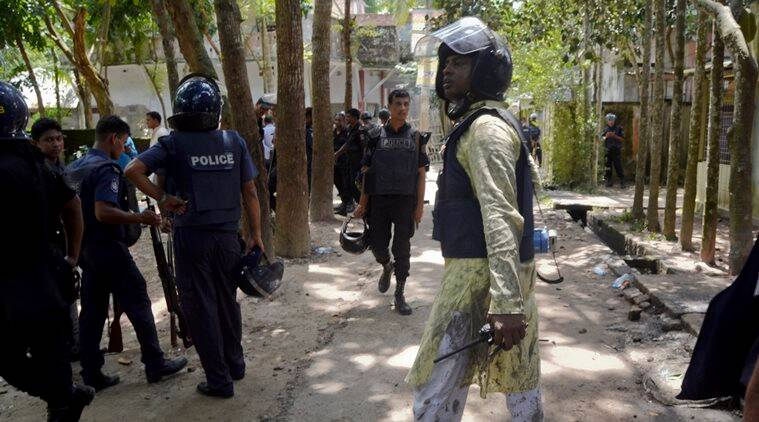 Bangladeshi policemen arrive near the scene of a blast in Kishoreganj, about 90 kilometers (60 miles) north of the capital of Dhaka, Bangladesh, Thursday, July 7, 2016. Islamic extremists hurled homemade bombs and engaged in a gunbattle with police guarding a large Eid prayer at the end of the holy Muslim month Thursday morning. The violence comes just days after a deadly hostage crisis at a restaurant in Dhaka. (AP Photo)