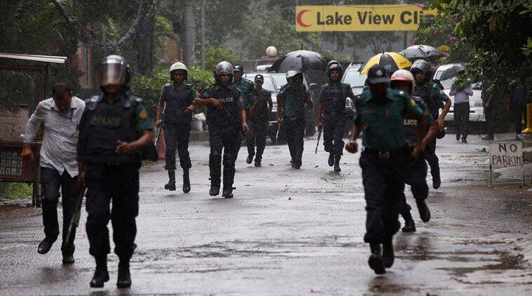 Policemen patrol on the road leading to the Holey Artisan Bakery and the O'Kitchen Restaurant after gunmen attacked, in Dhaka, Bangladesh, July 3, 2016. REUTERS/Adnan Abidi