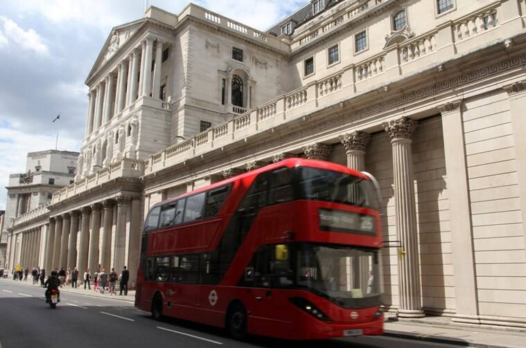 A bus carries passengers past the Bank of England in London on Thursday July 14, 2016. The Bank of England surprised financial markets by opting against cutting interest rates on Thursday, despite clear evidence of the initial economic damage caused by the country's vote last month to leave the European Union.  (AP Photo/Adela Suliman)