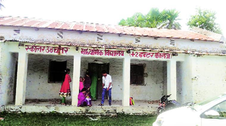 Scholar Uchcha Madhyamik Vidyalaya in Jalalpur is a two-room godown that doubles up as a waiting stop for 'shared autorickhaws'. (Express Photo: Santosh Singh)