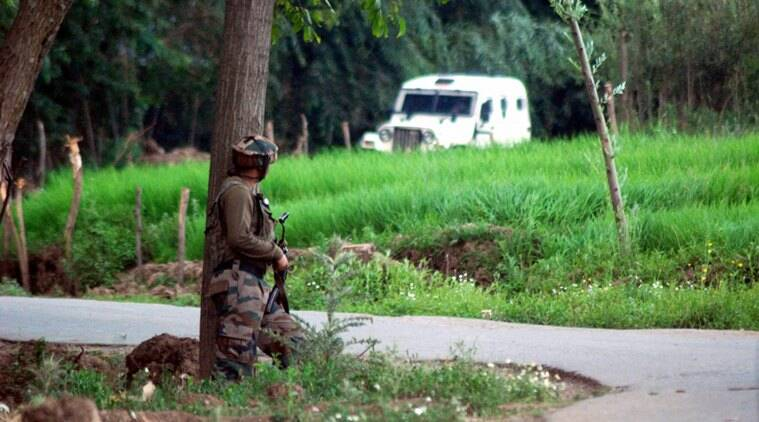 Anantnag: An Army Jawan takes position towards the site where most wanted Hizbul Mujahideen militant commander Burhan Wani along with his two associates were killed during an encounter at Kokarnag area of Anantnag District of South Kashmir on Friday. PTI Photo(PTI7_8_2016_000304B)