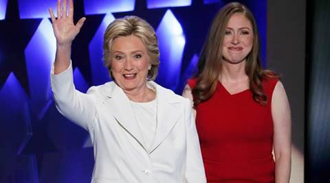 Democratic presidential nominee Hillary Clinton waves as her daughter Chelsea Clinton looks on during the final day of the Democratic National Convention in Philadelphia , Thursday, July 28, 2016. (AP Photo/J. Scott Applewhite)