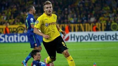 Dortmund's Immobile reacts after scoring past Arsenal's Koscielny in Champions League soccer match in Dortmund