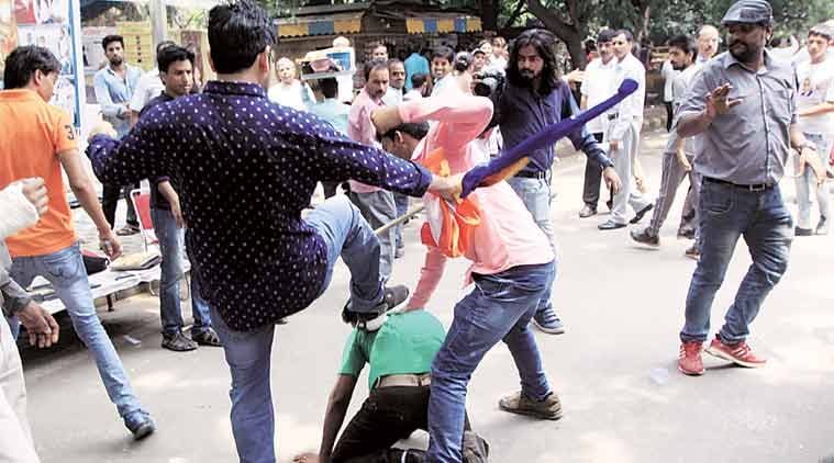 Clash between members of Singh Sena and Youth for Buddhist India. (Express Photo: Prem Nath Pandey)