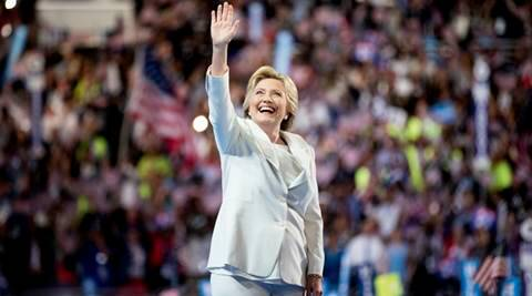 Democratic presidential candidate Hillary Clinton waves to the crowd as she takes the stage to speak during the fourth day session of the Democratic National Convention in Philadelphia , Thursday, July 28, 2016. (AP Photo/Andrew Harnik)