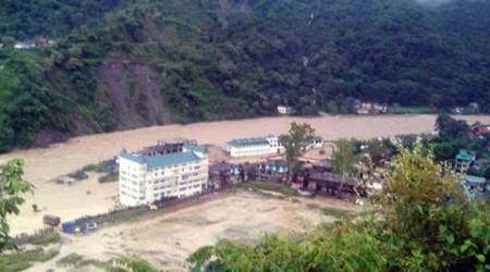 Flooded Dharampur market and bus station after a cloud burst in Mandi district on Saturday. Express Photo by Lalit Kumar. 08.08.2015.