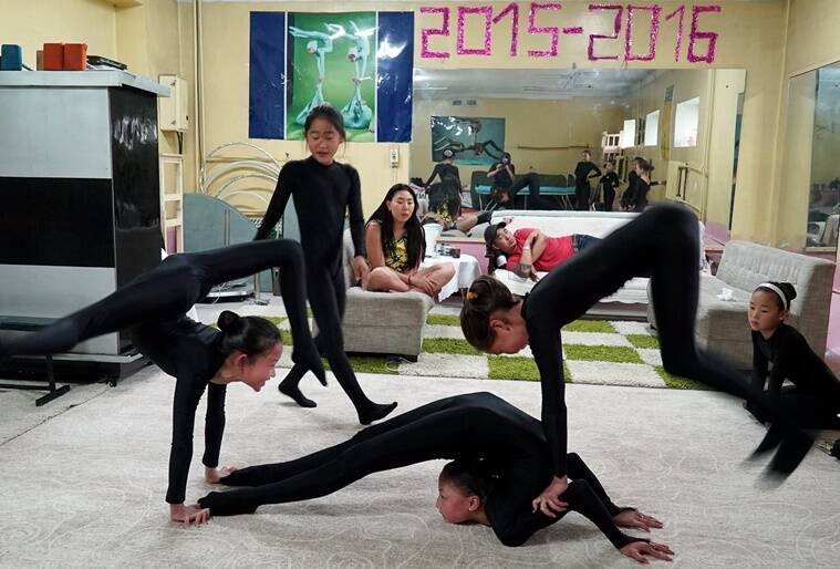 Young contortionists practice at a training school in Ulaanbaatar, Mongolia, July 4, 2016. Picture taken July 4, 2016. REUTERS/Natalie Thomas