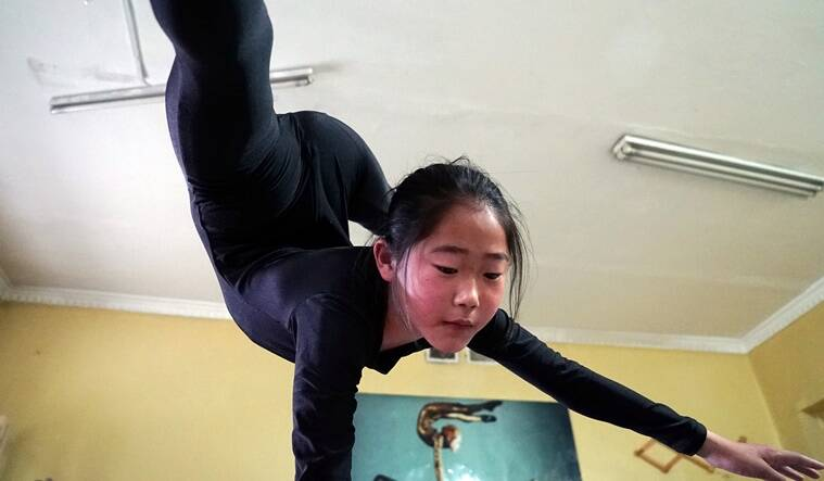 A young contortionist practices at a training school in Ulaanbaatar, Mongolia, July 4, 2016. Picture taken July 4, 2016. REUTERS/Natalie Thomas
