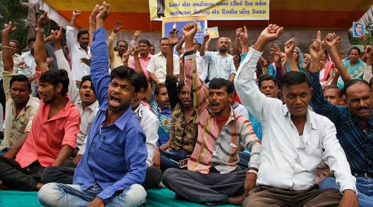 dalits, gujarat dalits, saurashtra region, Una, dalits attacked, Dalits gather outside court, dalit protest, dalit protests, gau rakshaks, gau rakshaks attack, india news, indian express news