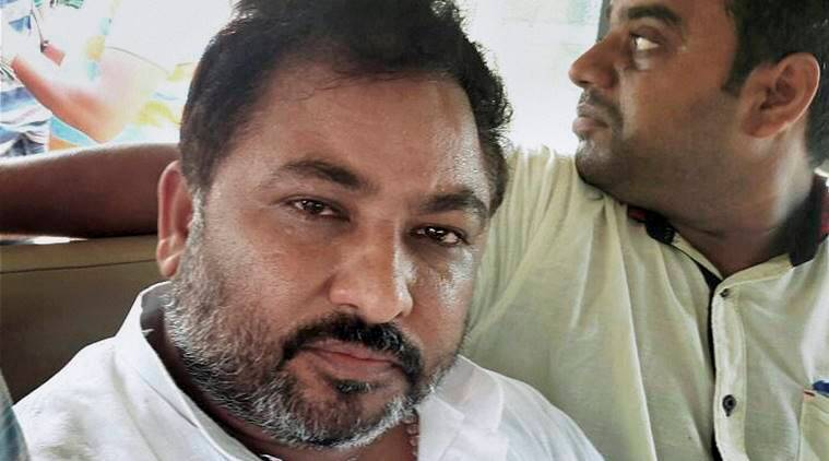 Dayashankar, Dayashankar singh, bjp leader dayashankar singh booked, dayashankar singh brother booked, dayashankar singh booked for fraud, mahindra and mahindra case dayashankar, india news, indian express