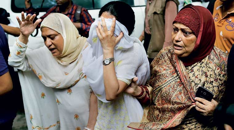 Relatives with Semin Rahman (face covered), whose son is missing since the attackers took hostages in Dhaka's Holey Artisan Bakery. (Reuters)