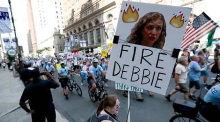 A supporters of Sen. Bernie Sanders, I-Vt., holds up a sign call calling for Debbie Wasserman Schultz, chairwoman of the Democratic National Committee to be fired, Sunday, July 24, 2016, in Philadelphia. The Democratic National Convention starts Monday. (AP Photo/Alex Brandon)