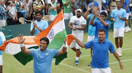 Leander Paes celebrates after winning the match against Korea. (Source: PTI)