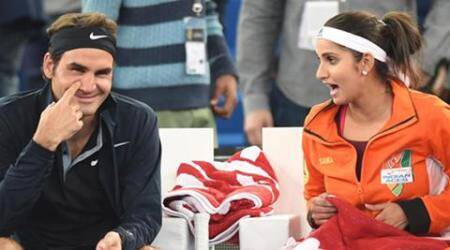 Good friends Roger Federer and Sania Mirza sharing a laugh. (Source: PTI)
