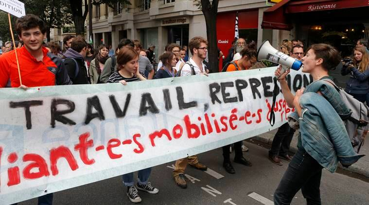 Students demonstrate during a protest against a labor law bill, in Paris, Tuesday, June 28, 2016. The Socialist government wants the reforms to make it easier to lay off employees, allow temporary extension of the work week and give company deals priority over industry-wide deals. (AP Photo/Francois Mori)