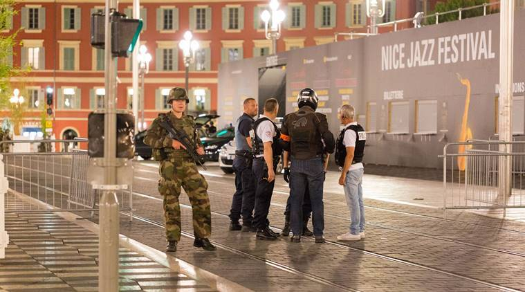 Police officers and a soldier stand by the sealed off area of after the Attack in Nice. (Source:AP)