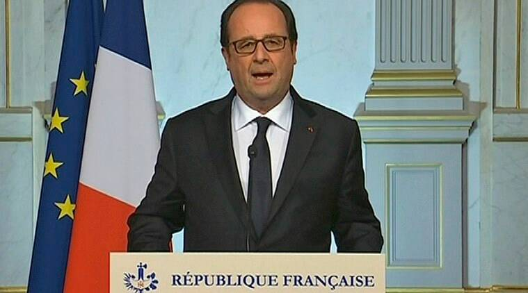 French President Francois Hollande makes a televised address in Paris early Friday July 15, 2016 after a truck drove onto a sidewalk for more than a mile, plowing through Bastille Day revelers who'd gathered to watch fireworks in the French resort city of Nice on Thursday, July 14. (French Pool via AP)