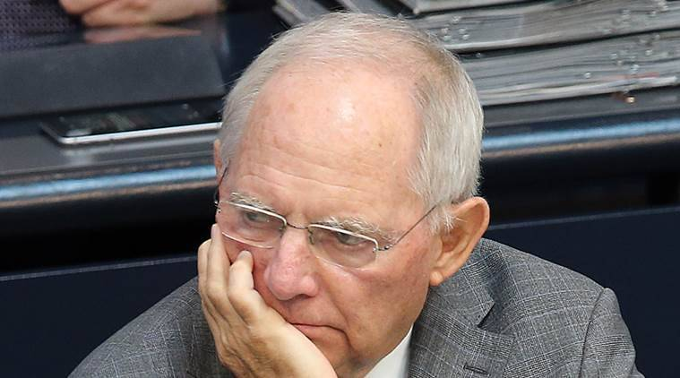 German finance minister Wolfgang Schaeuble watches a debate on the inheritance and gift tax at the German Bundestag parliament in Berlin, Germany, Friday, June 24, 2016, the day after Britain voted to leave the European Union. (Wolfgang Kumm/dpa via AP)