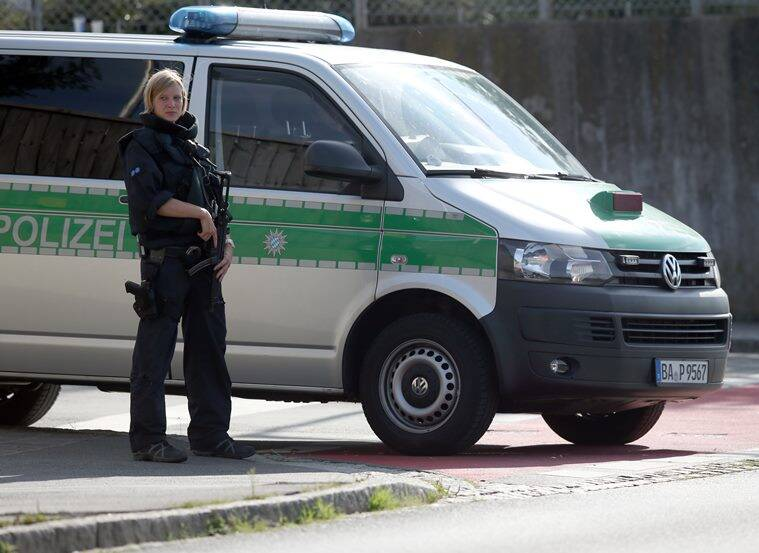 GERMANY OUT - Police standing near the preliminary reception center for refugees in Zirndorf, Germany, Wednesday July 27, 2016. A suitcase containing a spray can exploded near a refugee center and a police station in the German state of Bavaria on Wednesday, but no one was hurt, authorities said. (Daniel Karmann/dpa via AP)
