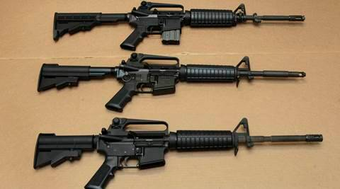 FILE -- In this Aug. 15, 2012 file photo, three variations of the AR-15 assault rifle are displayed at the California Department of Justice in Sacramento, Calif. While the guns look similar, the bottom version is illegal in California because of its quick reload capabilities. Omar Mateen used an AR-15 that he purchased legally when he killed 49 people in an Orlando nightclub over the weekend President Barack Obama and other gun control advocates have repeatedly called for reinstating a federal ban on semi-automatic assault weapons that expired in 2004, but have been thwarted by Republicans in Congress. (AP Photo/Rich Pedroncelli,file)