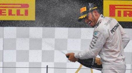 Mercedes driver Lewis Hamilton of Britain sprays champagne on the podium after winning the Formula One Grand Prix, at the Red Bull Ring in racetrack, in Spielberg, Austria, Sunday, July. 3, 2016. (AP Photo/Kerstin Joensson)