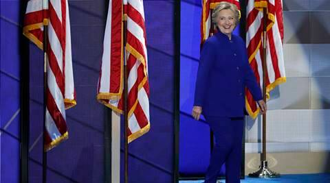 Democratic presidential nominee Hillary Clinton walks on stage after President Barack Obama's speech during the third day of the Democratic National Convention in Philadelphia , Wednesday, July 27, 2016. (AP Photo/J. Scott Applewhite)