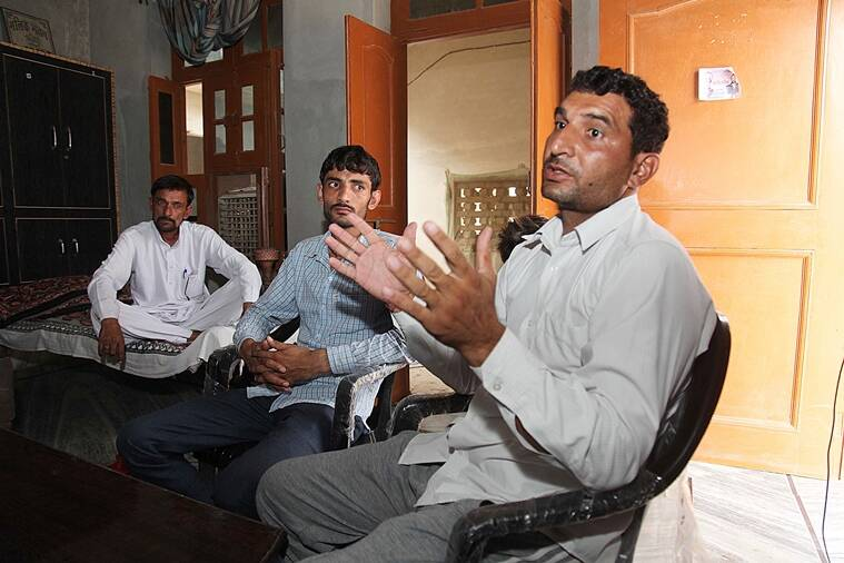 The sarpanch of village Rakhi Khas, with his uncle and father. (Express photo by Jaipal Singh)