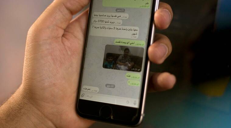 "On a chat on the WhatsApp app, an Islamic State group militant offers a woman and her children for sale, in this May 22, 2016, photo taken in northern Iraq. ""If you know one of the brothers who has a slave for sale, please let me know,"" it reads in Arabic. ""She wants her owner to sell her. He wants a price of $3,700 for her. She has two daughters, one 3 years old, the other 7 months."" IS is believed to be holding some 3,000 Yazidi women and girls as sex slaves, and as it loses territory, it has tightened its grip on them to prevent their escape. (AP Photo/Maya Alleruzzo)"