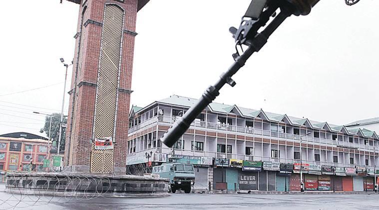 A deserted Lal Chowk during curfew in Srinagar, Sunday. (Source: Express photo by Shuaib Masoodi)