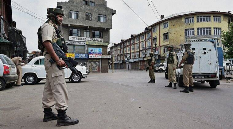 Security jawans during restriction and strike on fourth consecutive day in Srinagar on Tuesday. Authorities imposed restrictions in most parts of Valley following the killing of most wanted Hizbul Mujahideen commander, Burhan Muzaffar Wani, along with his two associates. (Source: PTI)