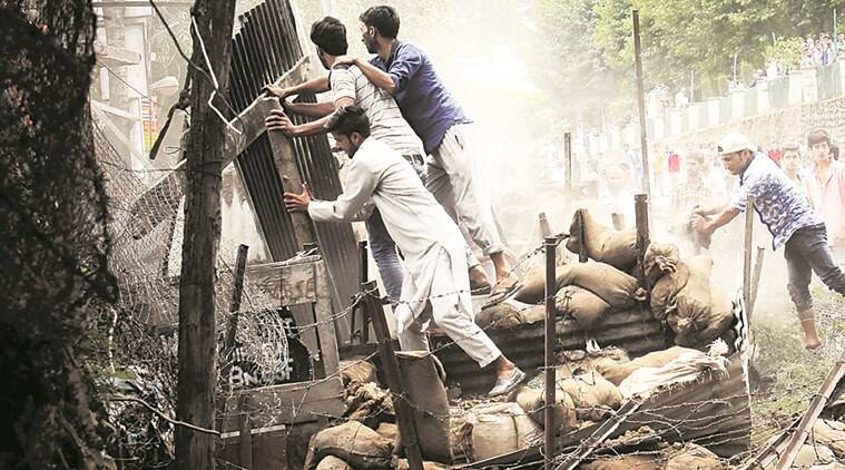 Protesters attack a security bunker in north Kashmir's Bandipora district on Monday. Shuaib Masoodi