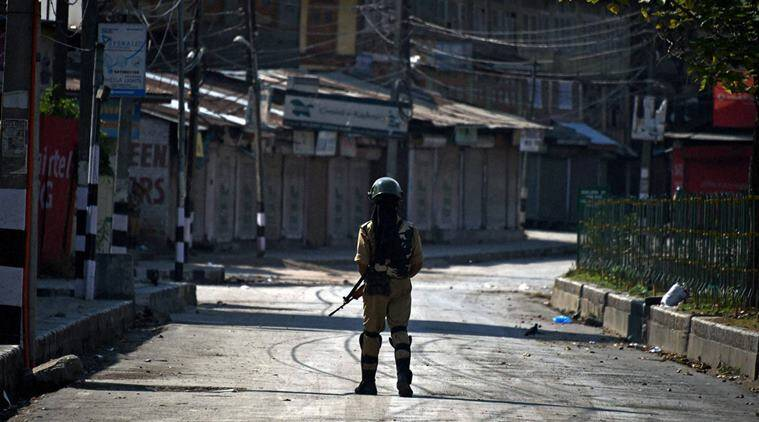 Srinagar: A security jawan stands guard during curfew in Srinagar on Friday. Curfew was reimposed on Friday in most parts of Kashmir valley to thwart a separatist march to Jamia Masjid in Srinagar. PTI Photo by S Irfan (PTI7_29_2016_000343A)