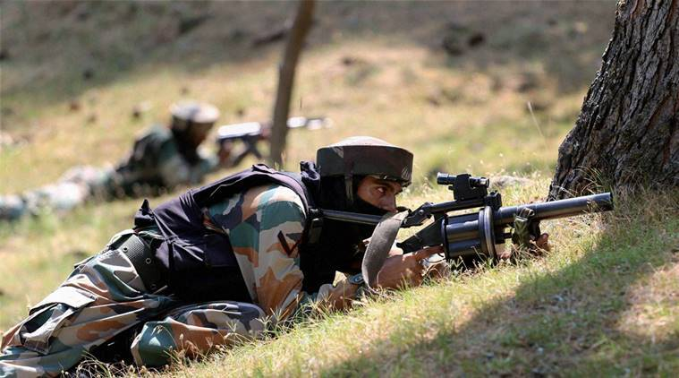Nowgam Sector : Army personnel take position at the site of encounter where two Army soldiers and two militants were killed, at Nowgam Sector on Line of Control (LoC) in north Kashmir on Saturday. PTI Photo(PTI7_30_2016_000127A)
